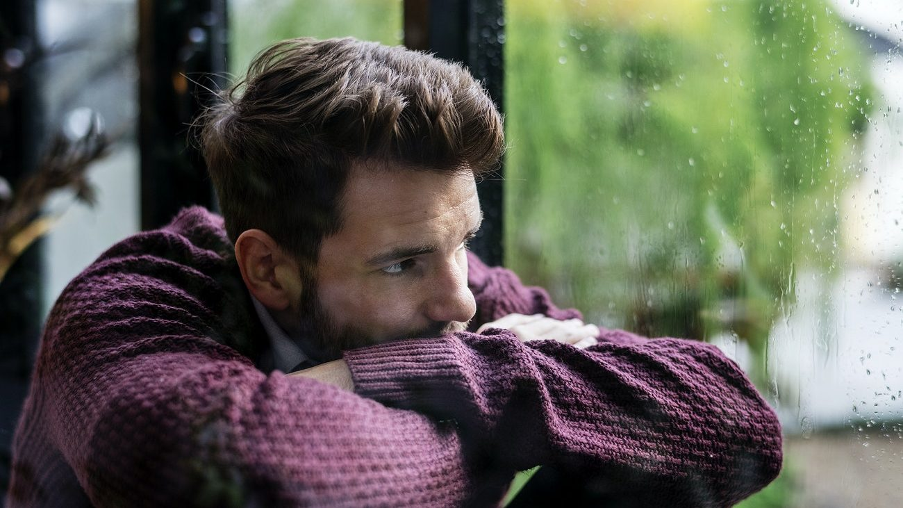 picture of a man looking out of a window