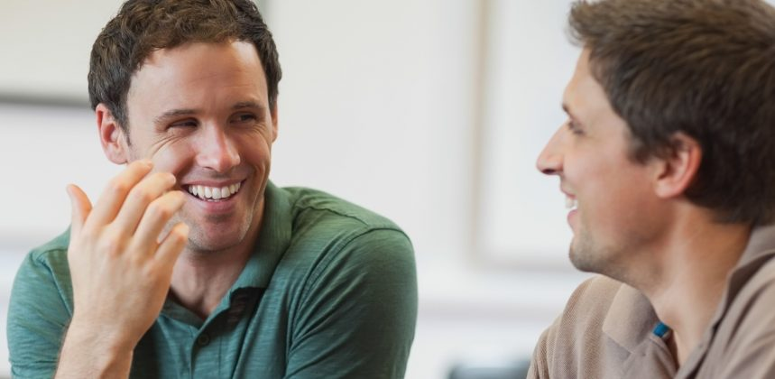 picture of two men talking and smiling