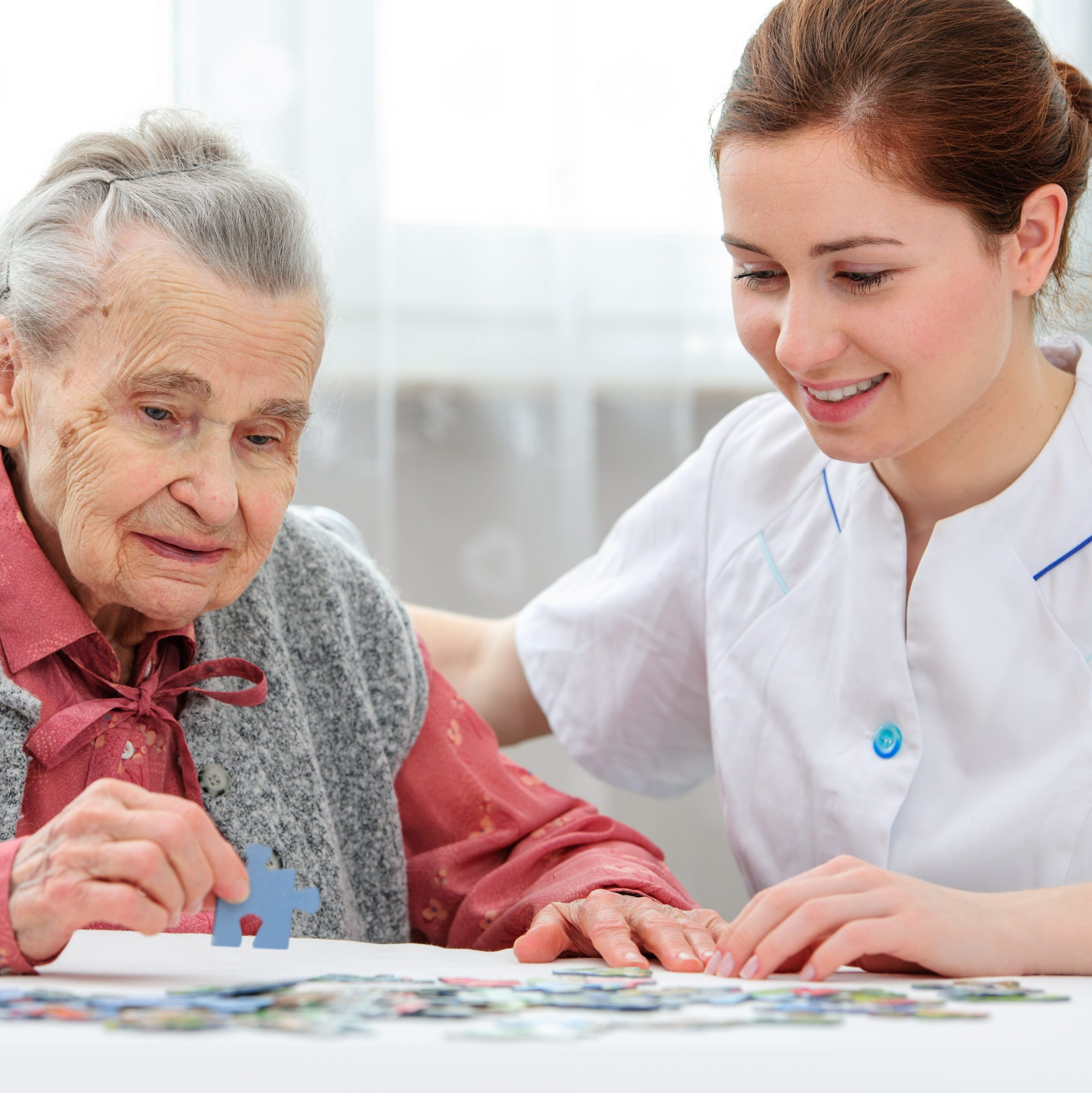 picture of a care worker helping an older lady