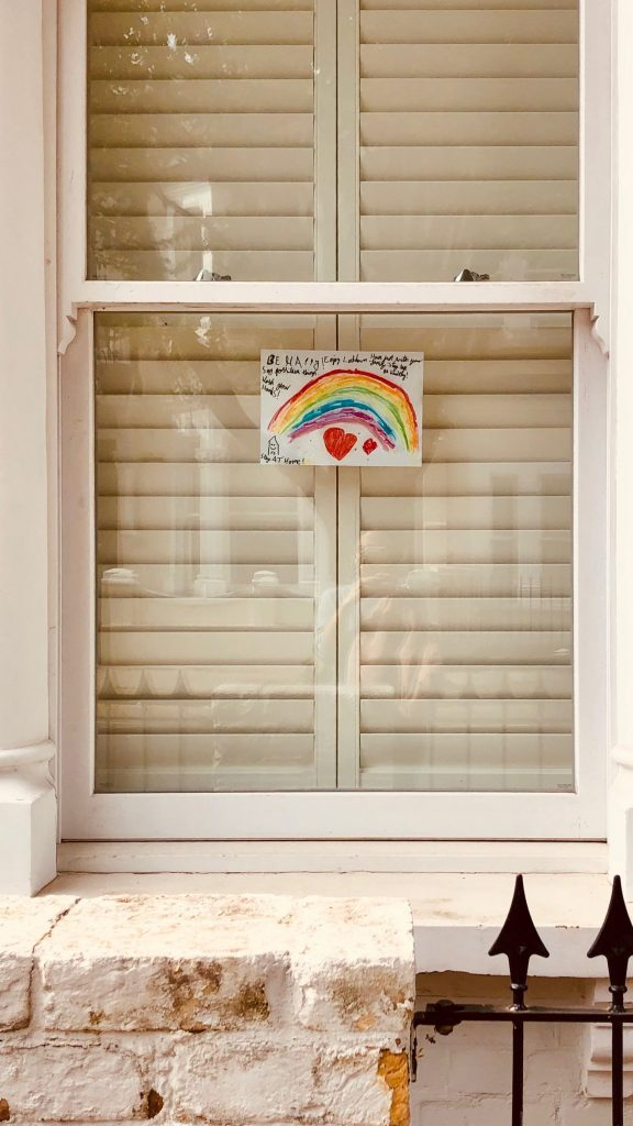 picture of a rainbow in a window