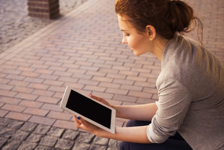picture of a girl reading a tablet